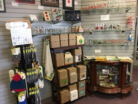 view of glassware, boxed gifts, and SmartWool accessories featuring the art of Charley Harper at the Tri-County store