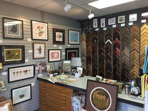 view of moulding samples and framed Charley Harper artwork at the Tri-County store