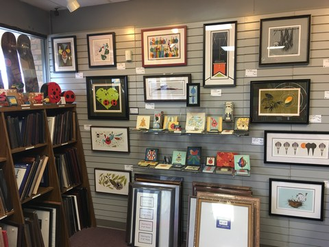 view of decorative tiles, ready-made frames, and framed Charley Harper artwork at the Tri-County store